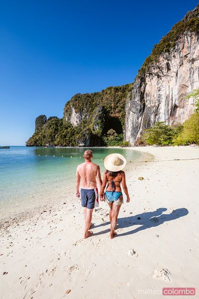 Man and woman walking on the beach, Hong island, Railay, Thailand