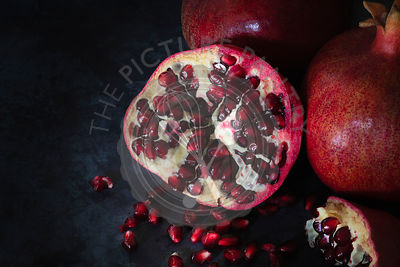 Red seeds inside a cut pomegranate.