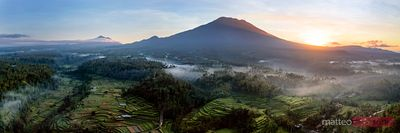 Panoramic of volcano and rice paddies at sunrise, Bali