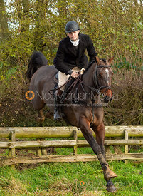 Alex Tordoff jumping a fence near Knossington Spinney - The Cottesmore Hunt at Owston 19/11