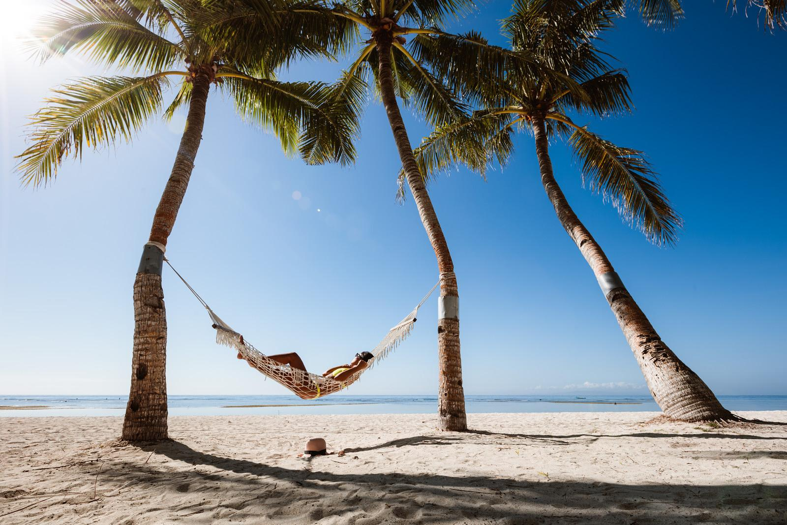 Woman relaxing in a hammock, Panglao, Bohol, Philippines