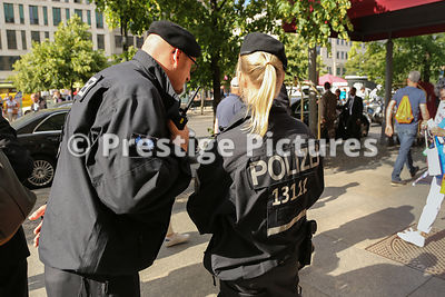 Two German Police Officers in the street Conferring
