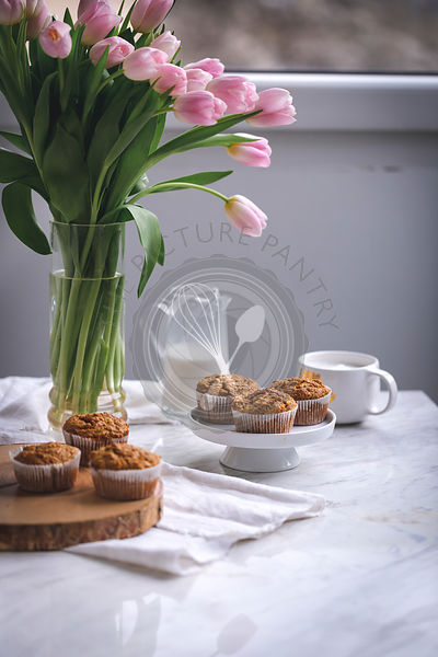 Carrot apple muffins on a white cake stand