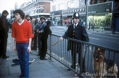"7.118/4 A moment of calm during the Brixton riots sparked by the oppressive ""Swamp '81""police operation targetting black youth."