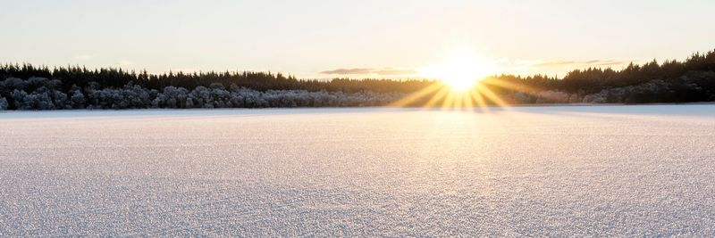 Image - Sunset on the ice covered Lake of Menteith