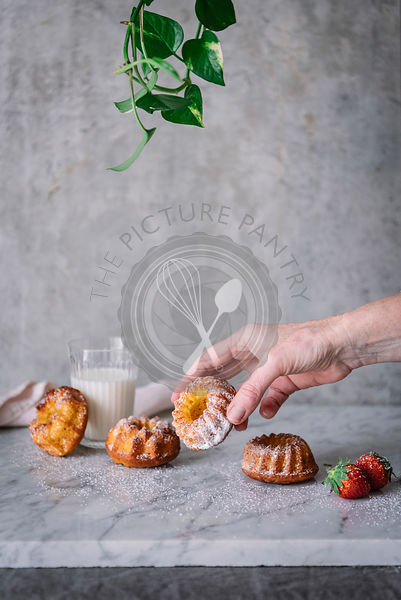 Mini bundt cakes on a marble work surface