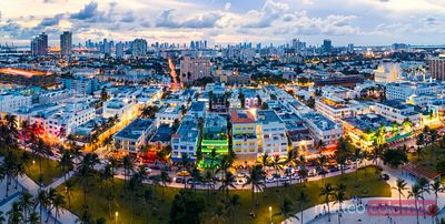 Aerial panoramic of Ocean drive and Miami downtown at dusk