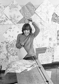 #75032  Decorating the walls with pages from a wallpaper catalogue, Liverpool Free School, Liverpool  1971.  Also known as th...