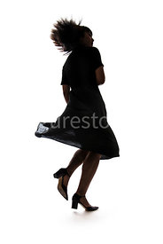 A silhouette of a woman running - shot from low level.