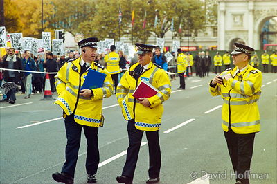 Police at a peace protest in the run up to the Iraq war. Central London..19 Nov 2001.