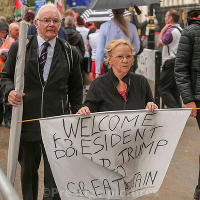 Trump supporters holding a welcome sign during President Trump's State visit