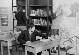#75037  Decorating the walls with pages from a wallpaper catalogue, Liverpool Free School, Liverpool  1971.  Also known as th...