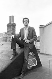 #74846,  Cornelius Cardew, 1970,  Cornelius Cardew (1936-1981), avant-garde musician and composer, on the rooftops, Fitzrovia...