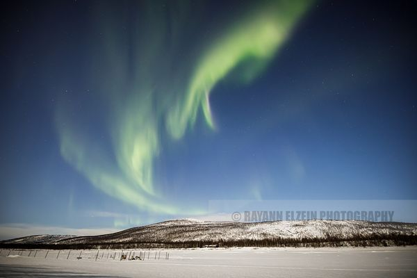 The northern lights on a full moon night above the Teno River in Utsjoki