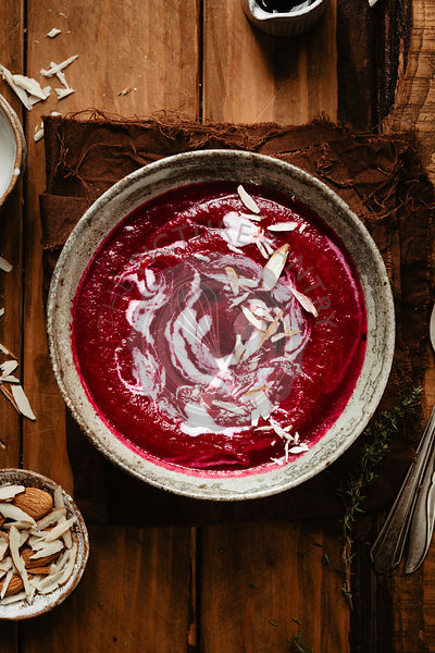 Healthy beet soup into into a bowl on a napkin