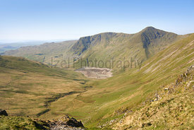 The two mountain summits of Yoke and Ill Bell a above Kentmere common and reservoir on a sunny morning in the Lake District UK.