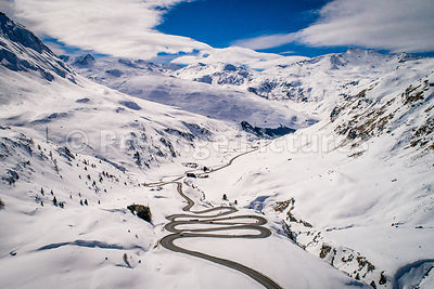 The twisting Julier Pass in the snow - Bivio, Switzerland