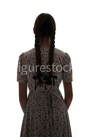 A silhouette of a 1940's girl in a summer dress – shot from eye-level.