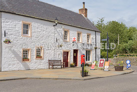 GLAMIS, SCOTLAND - JUNE19, 2018: The village of Glamis with corner shop, post office.