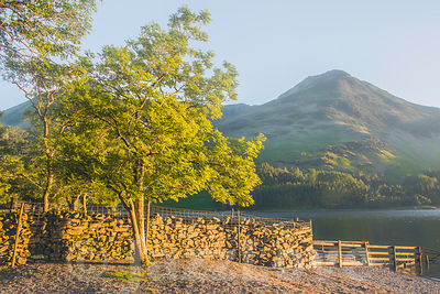Afternoon light at Buttermere lake shore in Lake District, UK.