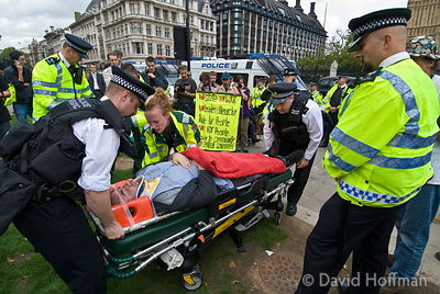 Photographer Marc Vallee injured by police during  a blockade of Parliament London October 9, 2006.