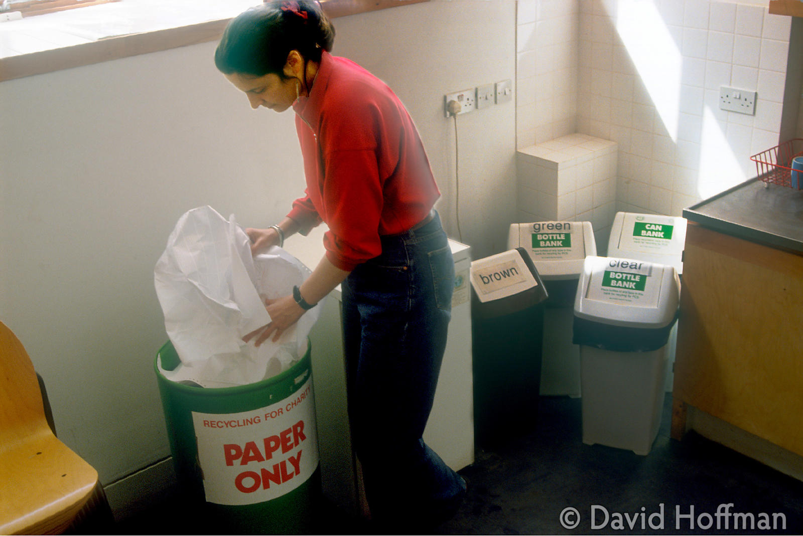 Collecting waste paper in a busy office. White office paper is excellent for recycling.