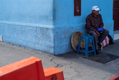 A man eats lunch on the streets, Antigua, Guatemala