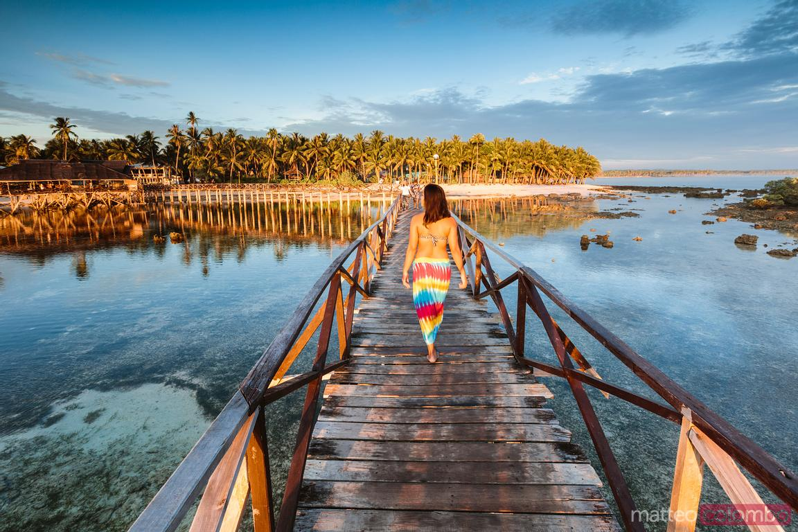 Woman walking on pier, Cloud 9, Siargao, Philippines