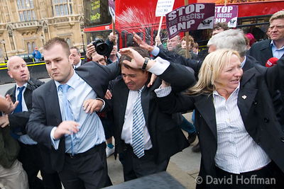 "Nick Griffin, BNP leader and newly elected MEP runs from a crowd of about 60-80 anti nazis chanting ""Nazi Scum. Off our stree..."