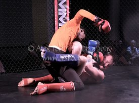 Stock image of amateur Mixed Martial Arts fighting for charity.