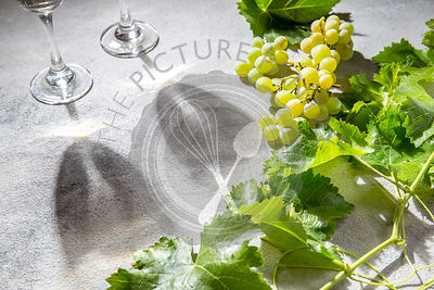 Wine concept. White wine and grape with leaves