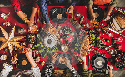 Flat-lay of friends celebrating New Year at festive table