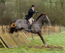 Jamie Collie jumping a hunt jump at Peakes - The Fitzwilliam Hunt visit the Cottesmore at Burrough House