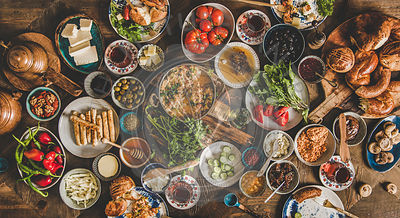 Flat-lay of traditional Turkish breakfast table with various snacks