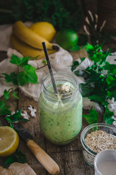 Fresh green smoothie on a rustic background