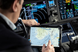 Pilot preparing the flight on a Microsoft Surface tablet