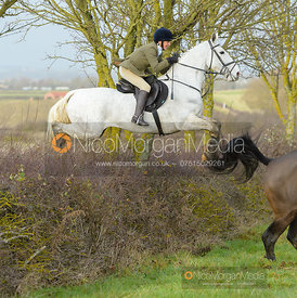 Tessa Vestey jumping a hedge at Sheepwash