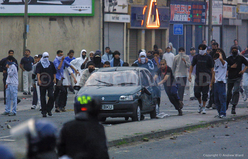 England , UK . 7.7.2001, Bradford . Asian youths rioting after the National Front arrived to be confronted by an Anti Nazi Le...