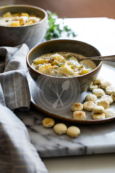 Potato, leek and bacon soup in a bowl served with mini scones.