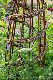 The Naturecraft Garden designed by Pollyanna Wilkinson at the RHS Hampton Court Palace Garden Festival 2019. Sponsor: Belvoir...
