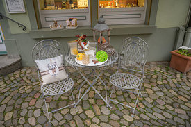 STAUFEN, GERMANY - OCTOBER 28 2019. A display table and chairs outside a gift shop in the old town of Staufen in Baden-Wurtte...