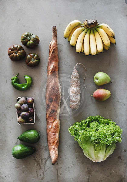 Flat-lay of healthy fresh vegetables, fruits, greens, bread and sausage