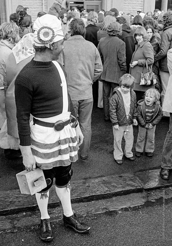 #77126,  The 'Nutters' Dance', Bacup, Lancashire,  1973.  On Easter Saturday every year the 'Coconut Dancers' gather at one b...