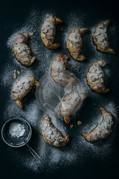 Almond Croissants in a dark background