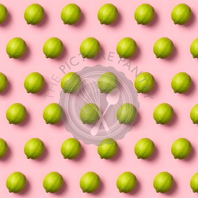 Limes pattern on pink background. Creative food concept. Flat lay