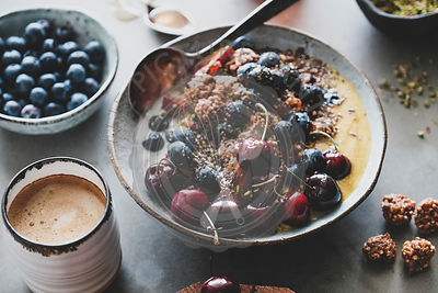 Healthy breakfast with quinoa granola coconut bowl and coffee