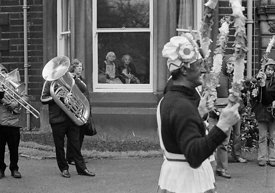 #77111,  The 'Nutters' Dance', Bacup, Lancashire,  1973.  On Easter Saturday every year the 'Coconut Dancers' gather at one b...