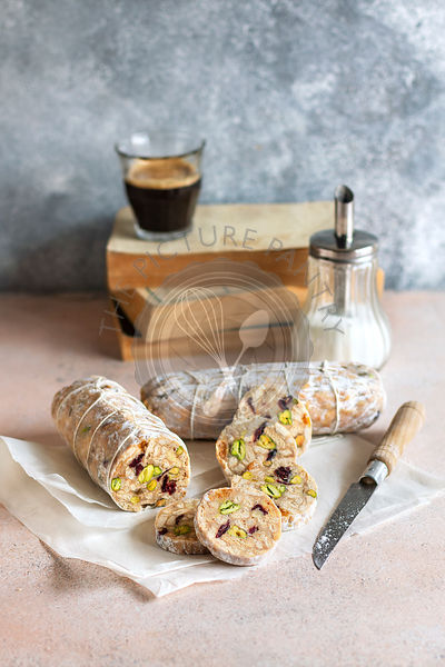 White chocolate salami with dried fruit and pistachio