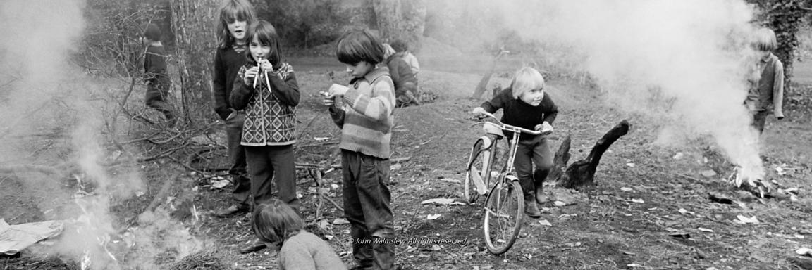 #72732   Lighting smokey bonfires in the grounds, Summerhill school, Leiston, Suffolk, UK. 1968.  From the book, 'Neill & Sum...