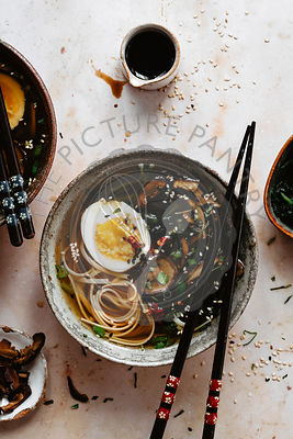 Miso soup with eggs and mushrooms into a bowl
